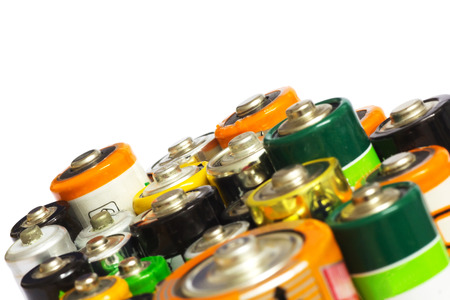 aa: Group of Old AA, AAA and C Batteries in Closeup on White. Selective Focus.