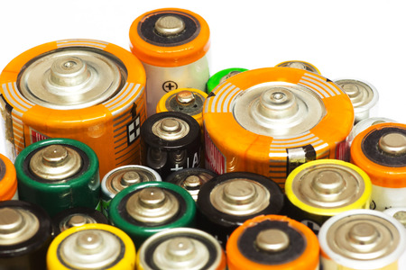 aaa: Group of Old AA, AAA and C Batteries in Closeup on White. Selective Focus.