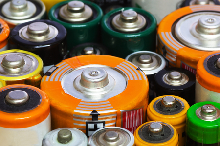 Group of Old AA, AAA and C Batteries in Closeup. Selective Focus.