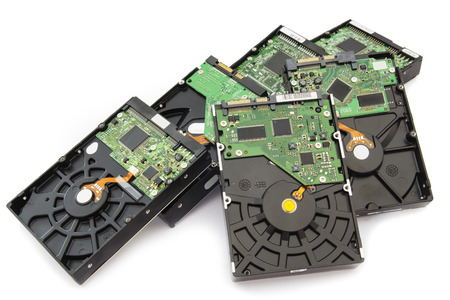 Stack of Old SATA and ATA Hard Disk Drives. Isolated on White Background.