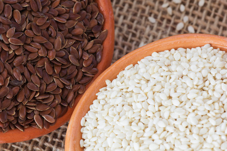 brown flax: Bowls with Brown Flax Seed and White Sesame Seeds. Stock Photo