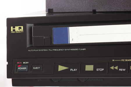 videocassette: Old VHS Video Cassettes and Old Video Recorder. Closeup. Foto de archivo