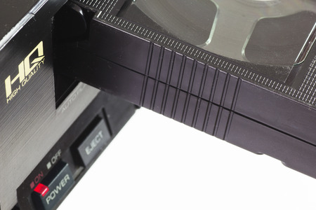vcr: Old VHS Video Cassettes and Old Video Recorder. Closeup. Stock Photo