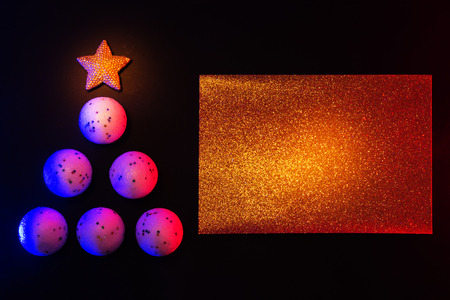 Christmas Balls in the Form of Christmas Tree, on Black Background with Paste Space.