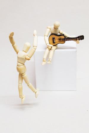 Wooden Dolls, Guitarist and Ballet Dancer. Music Concept. Stock Photo