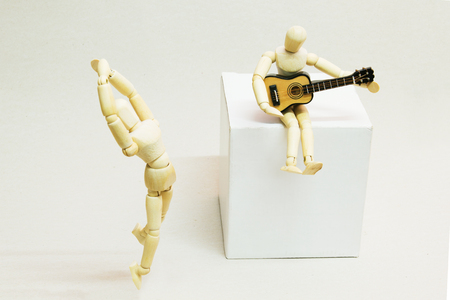 Wooden Dolls, Guitarist and Ballet Dancer. Music Concept. Stock Photo