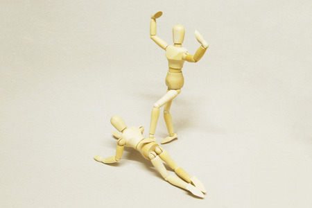 Wooden Dolls in Concept of Domination and Humiliation.  Stock Photo