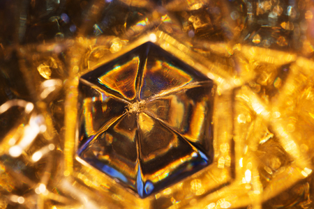 crystalline gold: Close up of detail of a old crystal glass. Abstract background. Stock Photo
