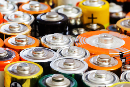 Group of old used batteries for recycling in different size. Selective focus. Standard-Bild