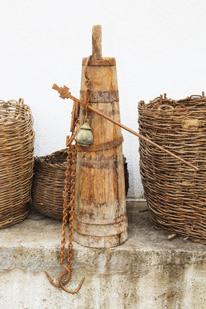 Old wooden stupa with a wooden pestle in it. Old home utensils more than 100 years old.