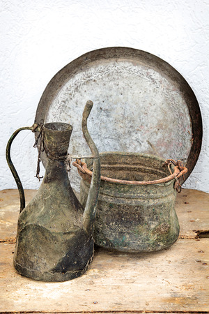Ancient traditional household utensils over old traditional table from Macedonian village.