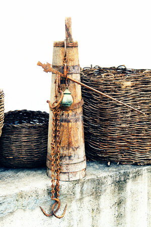 Old wooden stupa with a wooden pestle in it. Old home utensils more than 100 years old. Filtered. Banco de Imagens