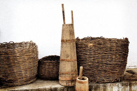 Old wooden stupa with a wooden pestle in it. Old home utensils more than 100 years old. Filtered. 스톡 콘텐츠