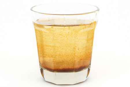 Glass with dirty water on white background. Water pollution concept. Banco de Imagens