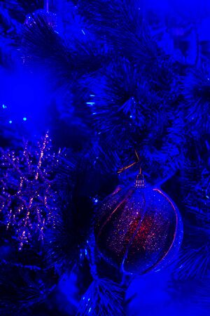 Close-up of Blue lighted Christmas tree decorations. Christmas Background.