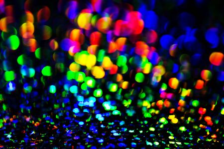Abstract and festive background with blurred circles. De focused blurred lights.