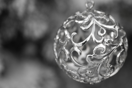 Silver christmas decoration with swirls