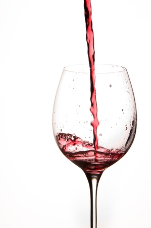 wines: Pouring Red Wine in a Glass with White background