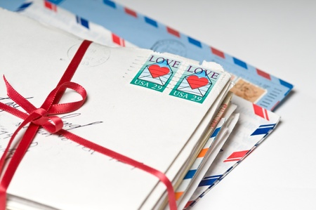 Stack of Love Letters with a Red Ribbon Stock Photo