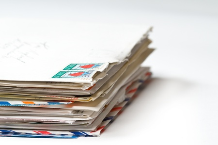 mail us: Stack of Love Letters with focus in the front