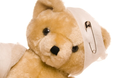 Teddy bear with a hurted head and arm