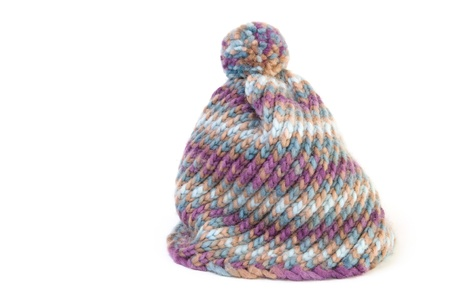 Knit hat on white background photo