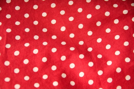 Red textile with white dots photo
