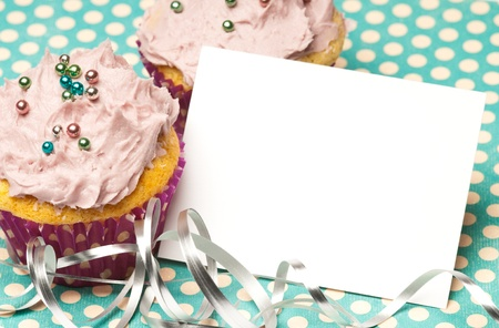 Cupcakes with a blank paper to write your own message photo