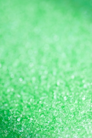 Green sugar sparkle background with focus in the front photo