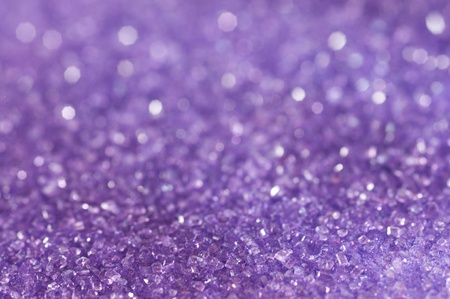 Purple sugar sparkle background with focus in the front