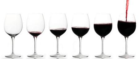 Van leeg glas vol glas wijn Stockfoto