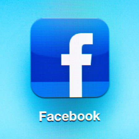 Facebook icon app on the iPad 3. Facebook is a social networking service.