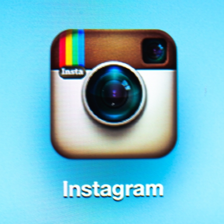 Instagram icon app on the iPad 3. Instagram is a free photo sharing application.