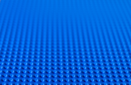Lego blue baseplate. The Lego toys were originally designed in the 1940s in Denmark and have achieved an international appeal. Editorial