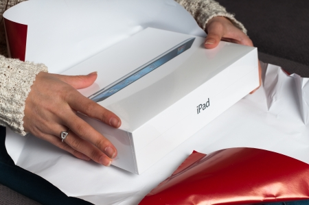 Unwrap a christmas or birthday gift and receive an iPad 3 Stock Photo - 16532261