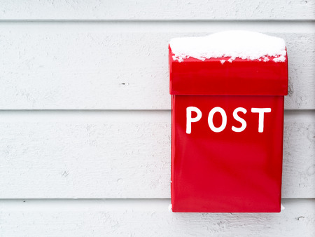you've got mail: Post and mailbox outside on a wooden wall with snow on. Any letters for Santa?