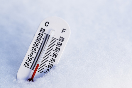 no snow: Thermometer in the snow with focus on the red.