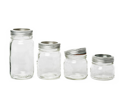 airtight: Empty glass jar with metal lid with white background Stock Photo