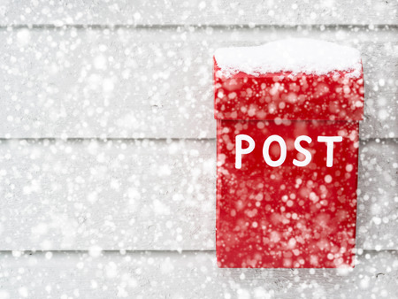 you've got mail: Red mailbox in snow Stock Photo