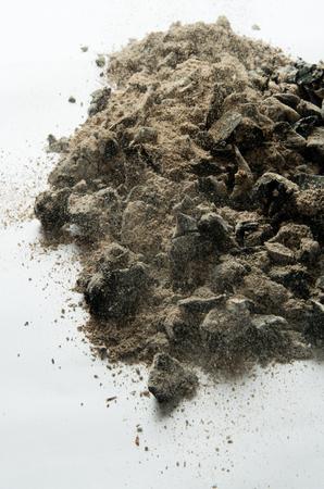 smoldering: Ashes on white background