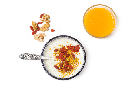 Overnight oatmeal breakfast with porridge and orange juice on white background. Top view. Stock Photo