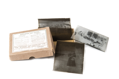 old fashioned sepia: Old glass plate negative with cardboard box on white background Stock Photo