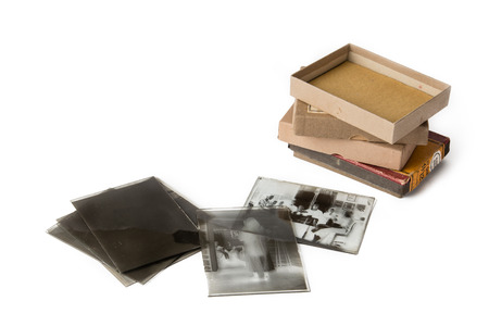 slide glass: Old glass plate negative with cardboard box on white background Stock Photo