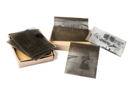 glass plate: Old glass plate negative with cardboard box on white background Stock Photo
