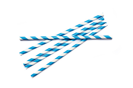 a straw: Several blue drinking straws in retro style with blue and white stripes on white background