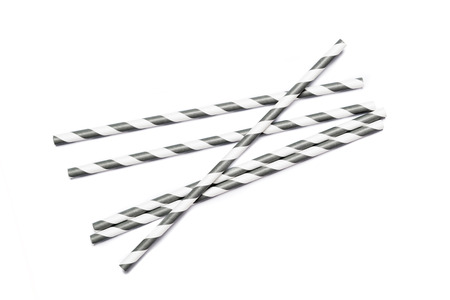 a straw: Several gray drinking straws in retro style with gray and white stripes on white background