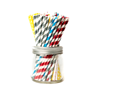 tubules: Several drinking straws in different colors in a jar and white background Stock Photo