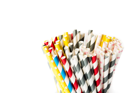 tubules: Several drinking straws in different colors on a white background