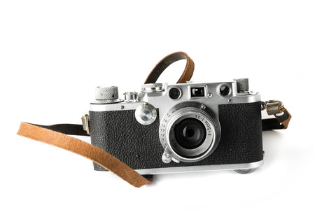A classic 35 mm camera from 1939 with white background