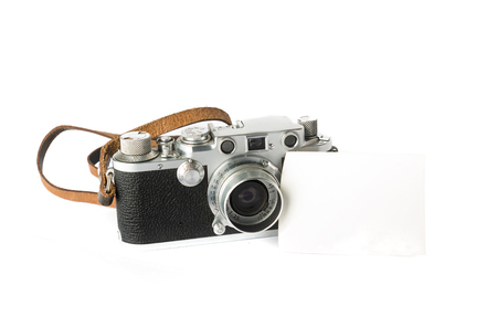 vintage photo: A classic 35 mm camera from 1939 with a blank photo. Put your own photo on the blank paper.